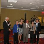 Barbara Dayney with family accepting Lifetime Achievement Award